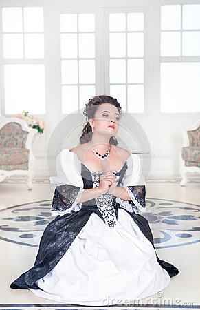 http://thumbs.dreamstime.com/x/beautiful-medieval-woman-praying-black-white-dress-61912345.jpg