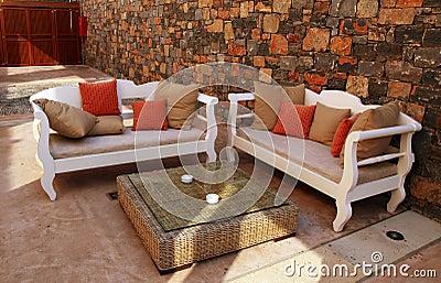 Beautiful mediterranean patio with white outdoor furniture(Greec