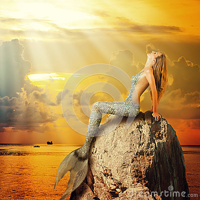 Free Beautiful Mermaid Sitting On A Rock Stock Photo - 54946470