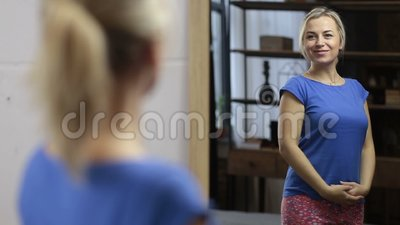 Joyful woman satisfied with reflection in mirror stock video footage