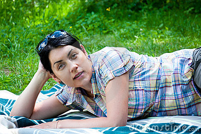Beautiful middle-aged woman on grass