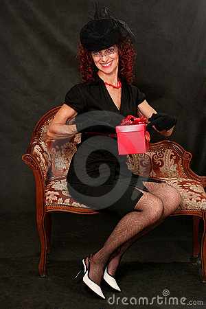 A beautiful middle-aged woman with a red gift