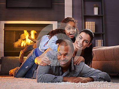 Beautiful mixed race family at home smiling