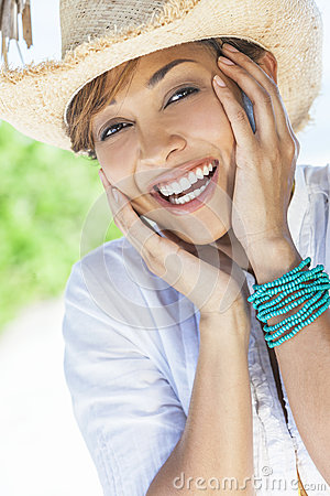 Beautiful Mixed Race Woman Laughing In Straw Hat