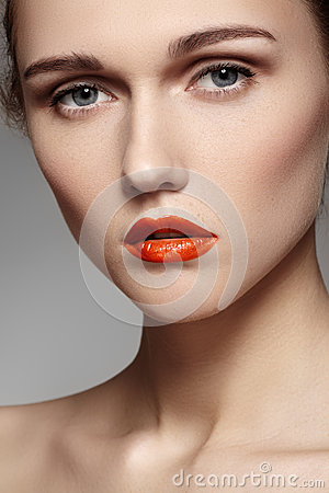 Beautiful model with bright red lips make-up, pure skin