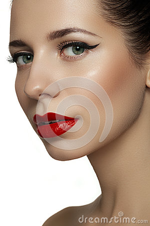 Beautiful model with bright red retro lips make-up