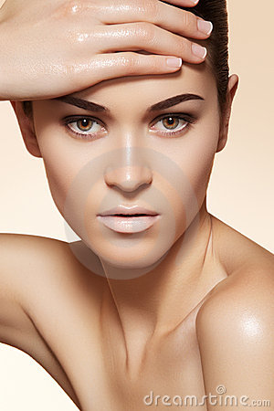 Beautiful model with clean skin & eyebrows make-up