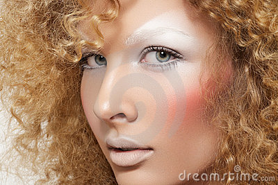 Beautiful model with curly hair & fashion make-up