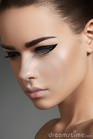 beautiful model face with fashion eyeliner makeup royalty