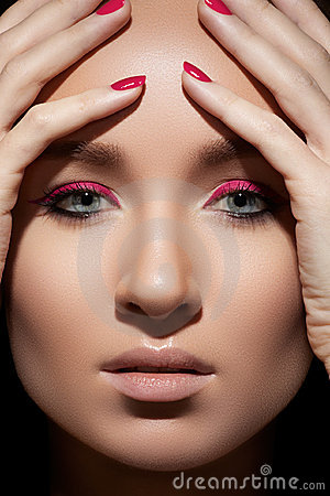 Beautiful model face with fashion make-up & nails