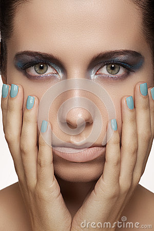Beautiful model face with fashion make-up & nails with bright manicure