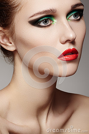 Beautiful model face with fashion make-up, red lips