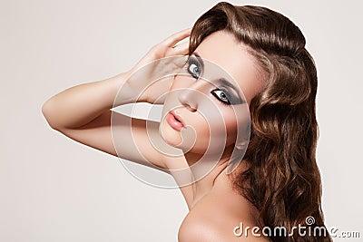 Beautiful model. Fashion make-up, curly retro hair