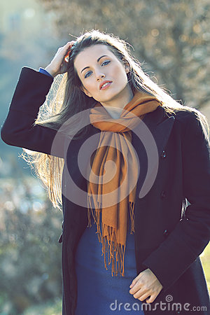 Beautiful model with hand in her long hairs