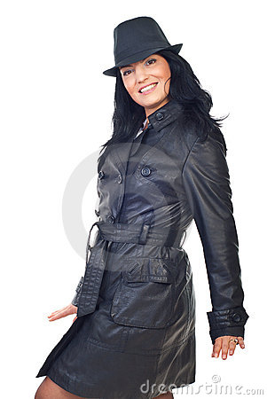Beautiful model in leather jacket and hat
