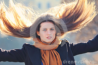 Beautiful model with long hair in motion