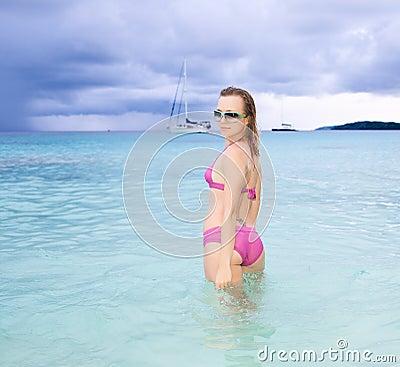 Beautiful model posing on the ocean