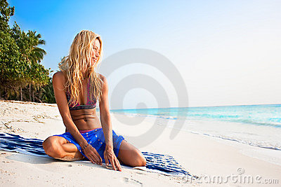 beautiful model relaxing on a tropical beach