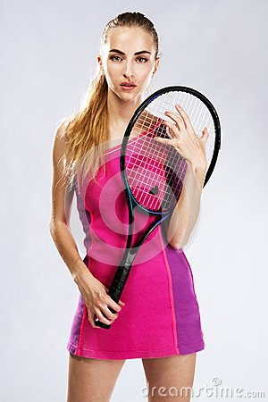 Beautiful model with tennis racket