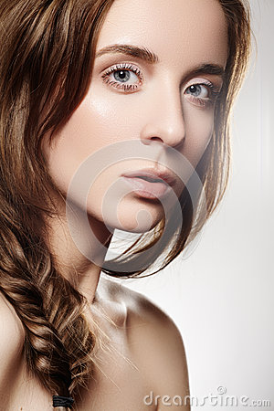Beautiful model woman with fashion romantic hairstyle, natural make-up, clean soft skin