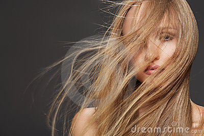 Beautiful model woman shaking head with long hair