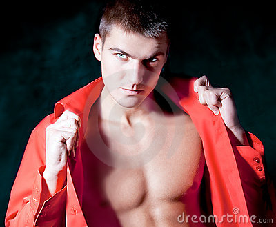 Beautiful modern macho man in red shirt  is posing