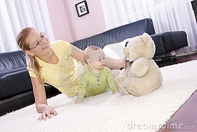 Beautiful mom with her son playing happily.