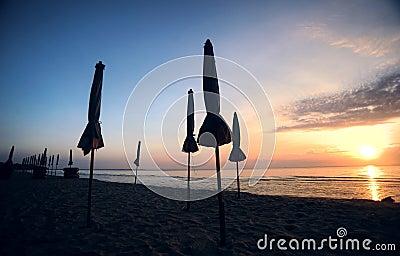 Beautiful morning sunrise with beach parasol