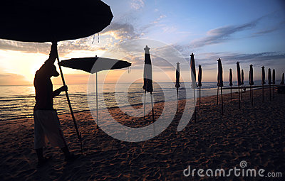 Beautiful morning sunrise with beach parasol