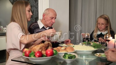 Beautiful mother serving meal to daugther stock video