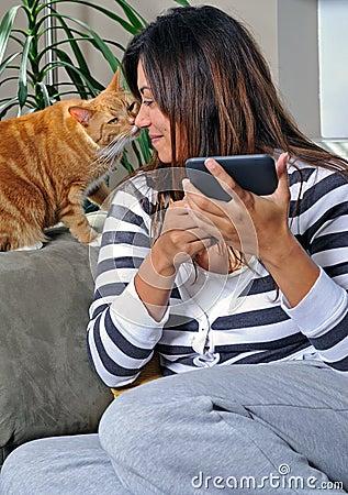 Beautiful multiracial woman getting a kiss - cat