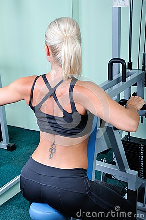 Beautiful muscular woman exercise in a gym