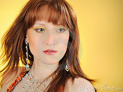 Beautiful mystic woman with golden make-up