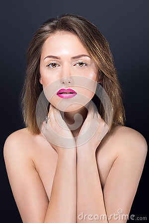Beautiful naked girl with bright makeup