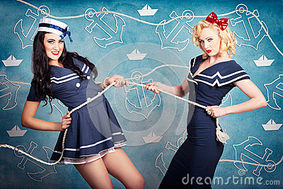 Beautiful navy pinup girls on marine background