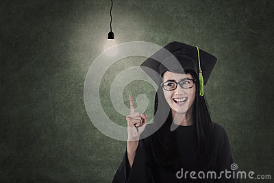 Beautiful nerd in graduation gown have idea