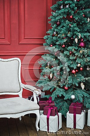 Beautiful New Year decorated classic home interior. Winter background. Living room with a Christmas decor. Holiday background. New Stock Photo