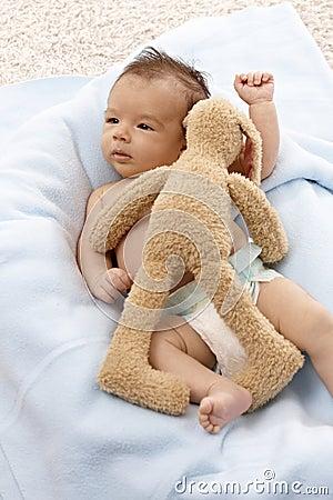 Beautiful newborn baby with plush bunny