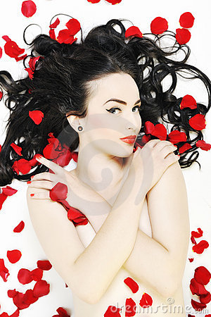 Beautiful nude woman with roses isolated on white