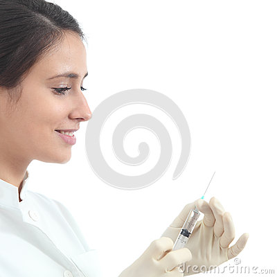Beautiful nurse preparing a syringe