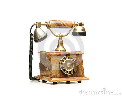 A beautiful old vintage telephone on white
