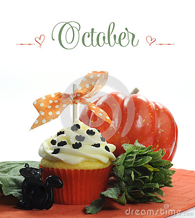 Free Beautiful Orange Halloween Theme Cupcake With Seasonal Flowers And Decorations For The Month Of October Stock Photo - 40685910
