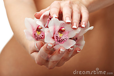 Beautiful orchid over woman body