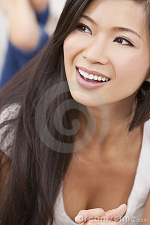 Beautiful Oriental Asian Woman Relaxing & Smiling