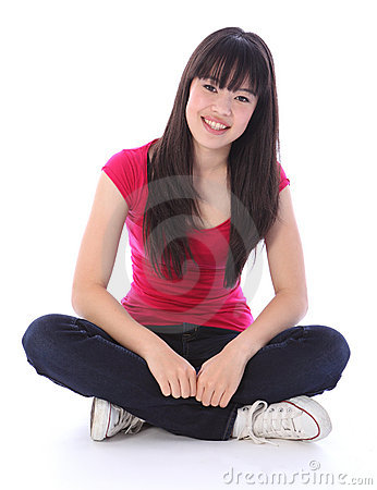 Beautiful oriental teenager girl cross legged