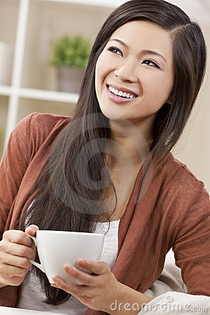 Beautiful Oriental Woman Drinking Tea or Coffee