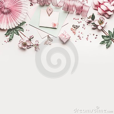 Free Beautiful Pastel Pink Work Space With Flowers Decoration,ribbon, Hearts, Bow And Card Mock Up On White Desk Background, Top View Stock Images - 110130574