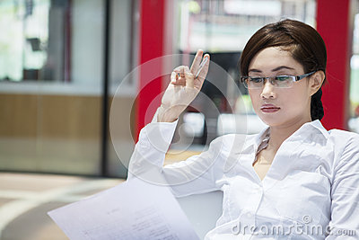 Beautiful pensive businesswoman at workplace