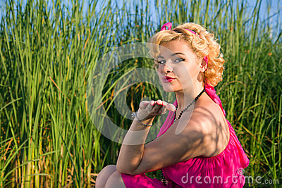 Beautiful pin-up woman blowing a kiss