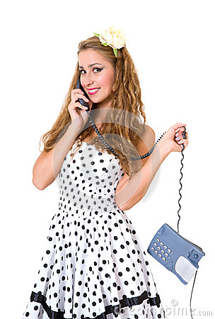Beautiful pinup girl talking on phone, isolated